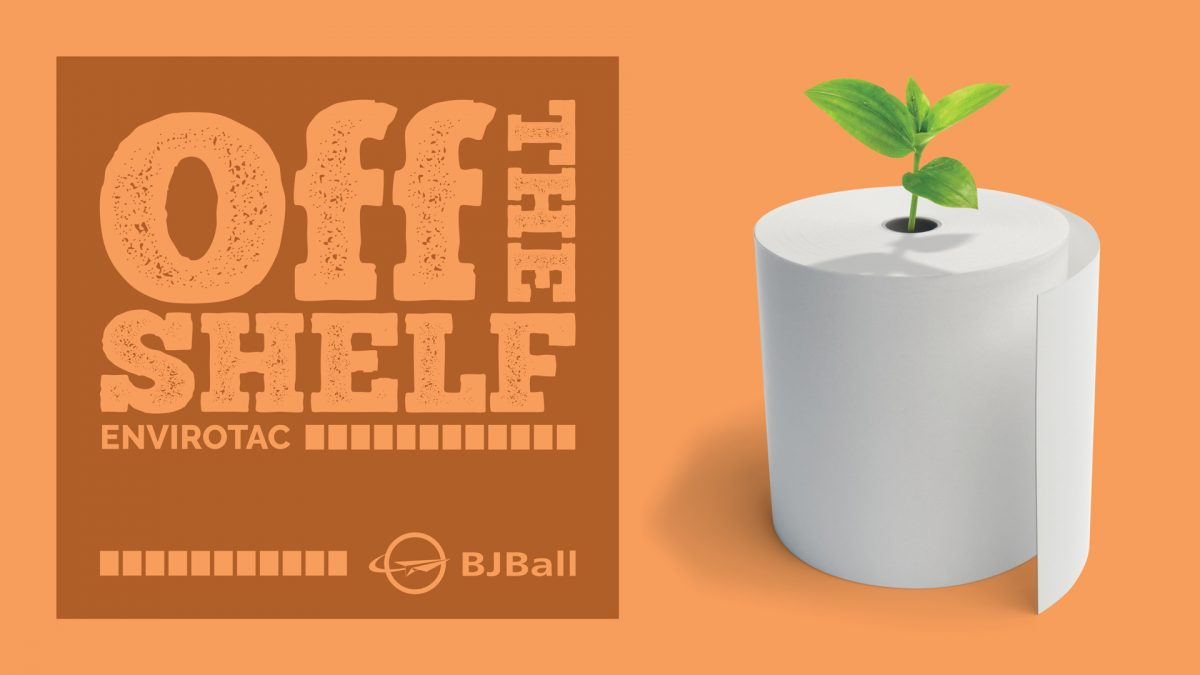 Adhesive material in roll form with a green plant growing up from its centre